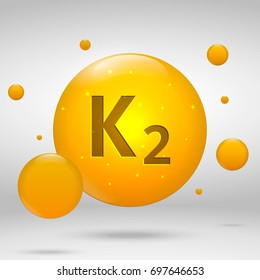 Vitamin K2 gold icon. menaquinone drop pill capsule. Vitamin complex design