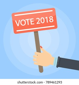 Vote 2018 sign in hand. Presidential election in Russia.