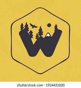 W letter logo with mountains peaks and trees on a landscape line pattern. Adventure and outdoor vintage emblem perfect for t-shirts, apparel and other merchandise.