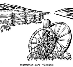 Wagon wheels and rustic fence