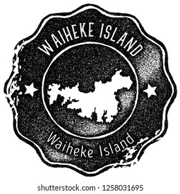 Waiheke Island map vintage stamp. Retro style handmade label, badge or element for travel souvenirs. Black rubber stamp with island map silhouette. Vector illustration.