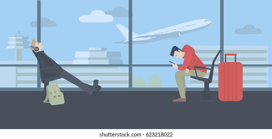 Waiting at the airport. Men with luggage sitting next to a window, terminal building and flying plane in the background. Midday.