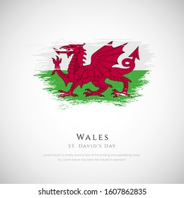 Wales flag made in brush stroke background. st. david's day day of Wales. Creative Wales national country flag icon. Abstract painted grunge style brush flag background.