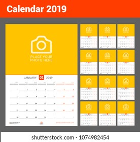 Wall calendar for 2019 year. Vector design print template with place for photo. Week starts on Monday. Set of 12 pages. Portrait orientation