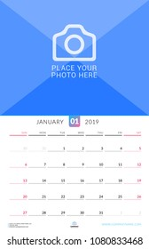 Wall calendar for January 2019. Vector design print template with place for photo. Week starts on Sunday. Portrait orientation