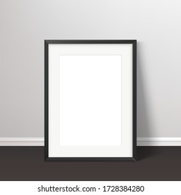 Wall poster realistic mockup. Black frame standing on the floor with passepartou mock up. Vector illustration.