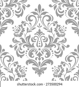 Wallpaper in the style of Baroque, damask. A seamless vector background. Gray and white ornament.