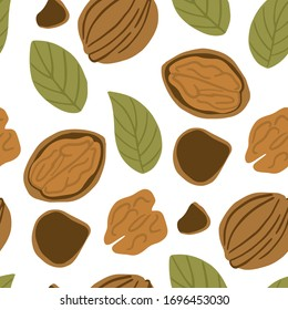 Walnut seamless pattern. Ripe walnut kernels in flat. Walnut on white background. Nut ornament for wallpapers, polygraphy, textiles, web page design, surface textures
