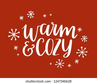 Warm and cozy lettering design. Hand-drawn lettering with snowflakes. Winter greeting card. Vector hand lettered Christmas design.