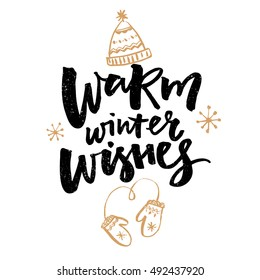 Warm winter wishes text. Christmas greeting card with brush calligraphy and hand drawn illustrations of mittens and hat.