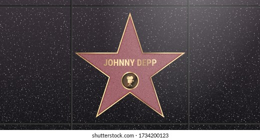 Warsaw, Poland – May 17, 2020: Hollywood star on celebrity walk of fame boulevard. Johnny Depp iconic movie actor star name on celebrity walk of fame on black floor background with light texture
