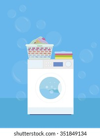 Washing machine with a basket of laundry on a blue background - vector illustration