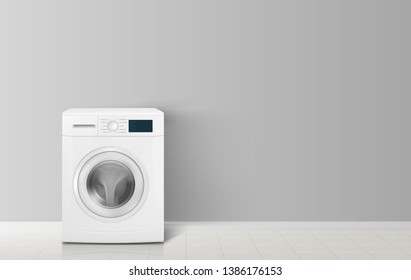 Washing machine front view on a white wall background