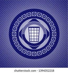 wastepaper basket icon inside badge with denim texture