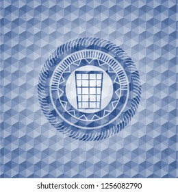 wastepaper basket icon inside blue emblem with geometric pattern background.