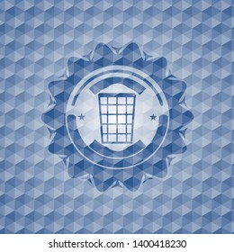 wastepaper basket icon inside blue hexagon badge.