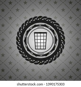 wastepaper basket icon inside dark emblem. Retro
