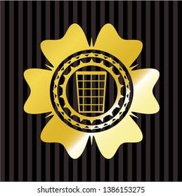 wastepaper basket icon inside gold shiny emblem