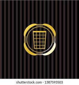 wastepaper basket icon inside gold badge or emblem