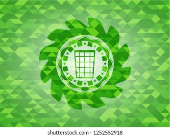 wastepaper basket icon inside green emblem with mosaic background