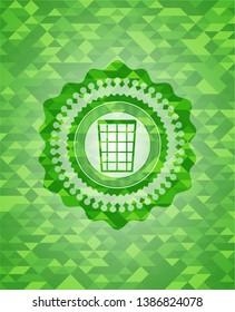 wastepaper basket icon inside green mosaic emblem