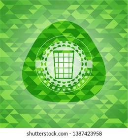 wastepaper basket icon inside green emblem. Mosaic background