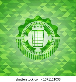 wastepaper basket icon inside green emblem with triangle mosaic background