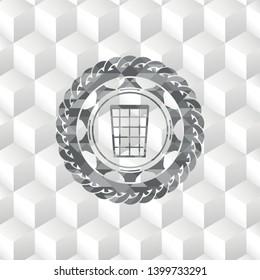 wastepaper basket icon inside grey emblem with geometric cube white background