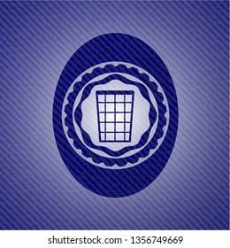 wastepaper basket icon inside jean or denim emblem or badge background