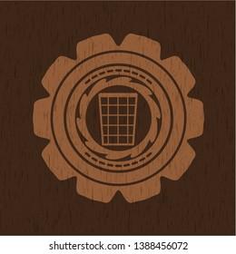wastepaper basket icon inside retro style wood emblem
