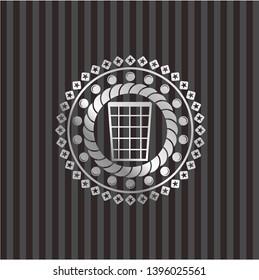 wastepaper basket icon inside silver badge or emblem