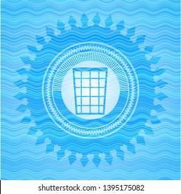 wastepaper basket icon inside water concept emblem background.