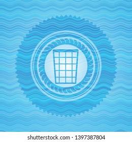 wastepaper basket icon inside water emblem.