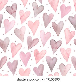 Watercolor hearts seamless background. Pink tiled pattern from heart shapes isolated on white. Romantic texture in pastel colors hand drawn with paints.
