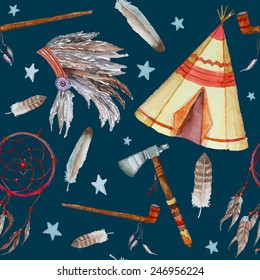 Watercolor tribal seamless pattern. Background with vintage hand drawn design elements: tepee, peace pipe, Indian hat, dreamcatcher, axe, feathers and stars. Vector illustration on dark colour