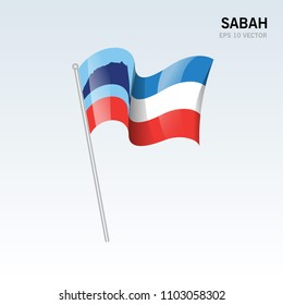 Waving flag of Sabah state and federal territory of Malaysia isolated on gray background