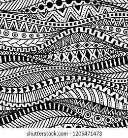 Wavy seamless ethnic pattern. Black and white print for textiles hand-drawn in the style of doodle. Aztec and tribal motifs. Vector illustration.