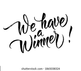 We have a winner! card. Hand lettering. Modern brush calligraphy with brush texture. Handwritten phrase for your design. Vector illustration EPS 10.