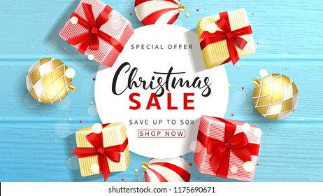 Web banner for Christmas sale. Elegant background with top view on realistic gift boxes and Christmas balls on rustic wooden texture. Vector illustration with confetti and effect bokeh.