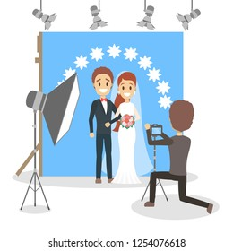 Wedding couple in the photostudio making photoshoot for memory. Happy beautiful bride and handsome groom. Various equipment such as camera and light. Flat vector illustration
