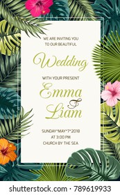 Wedding event invitation card template. Exotic tropical jungle rainforest bright green palm tree and monstera leaves hibiscus flowers border frame on dark background. Vertical portrait aspect ratio.