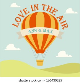 Wedding invitation card with flying hot air balloon in the sky with text