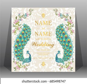 Wedding Invitation card templates with peacock patterned and crystals on on lace floral pattern background.