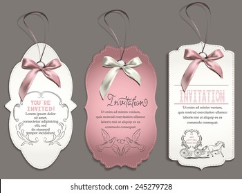 wedding invitation card with vintage design elements and pink ribbons