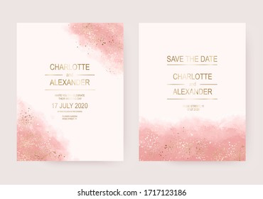 Wedding invitation cards with gold splatter and pink watercolor texture.