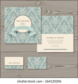Wedding invitation, save the date cards, place card. Wedding set on a wooden background.