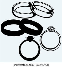 Wedding rings icon. Isolated on blue background. Vector silhouettes