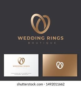 Wedding Rings Logo. Wedding Salon emblem. Elegant gold wedding rings like gold heart. Jewelry shop. Business card.