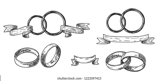 Wedding rings set. Wedding rings or bands in a vintage retro engraved etching woodcut style