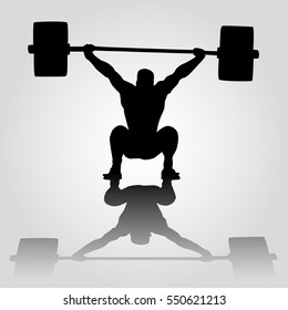 Weightlifter is sitting with barbell. Snatch. silhouette of athlete doing snatch exercise. weightlifting.